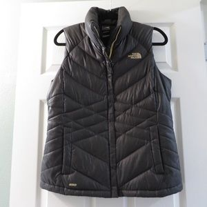 Shiny black and beige north face puffer vest